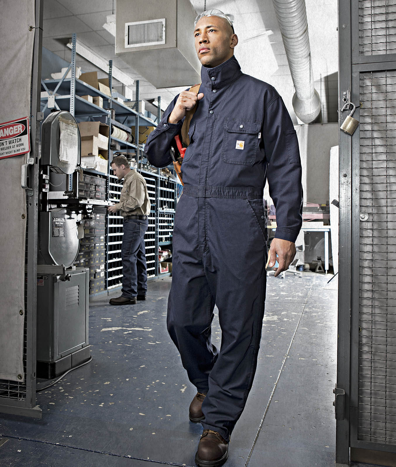 Worker in dark blue flame resistant coveralls